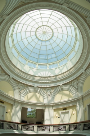 The sunlit glass dome of Van Wormer Hall casts delicate shadows on the scene below.