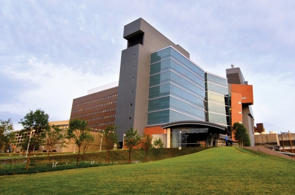 The Care Crawley building on the University of Cincinnati medical campus is a mix of glass and bricks and mortar.