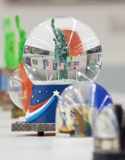 A close-up of a Statue of Liberty snow globe displayed in the University of Cincinnati's DAAP library.