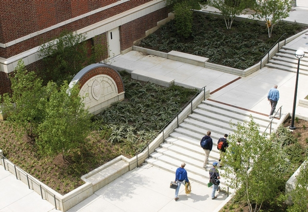 An overhead view of students walking up steps nestled between buildings -- an area of the University of Cincinnati campus called The Mews.