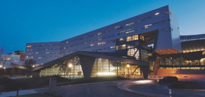 A nighttime view of the University of Cincinnati's campus recreation center.