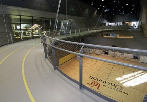Runners on the four-lane, 1/8-mile suspended track can look down on six basketball courts.