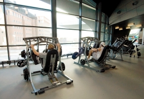 A few students make use of the fitness machines at the Campus Recreation Center. The fitness floor boasts more than 200 machines and 21,000 pounds of free weights.