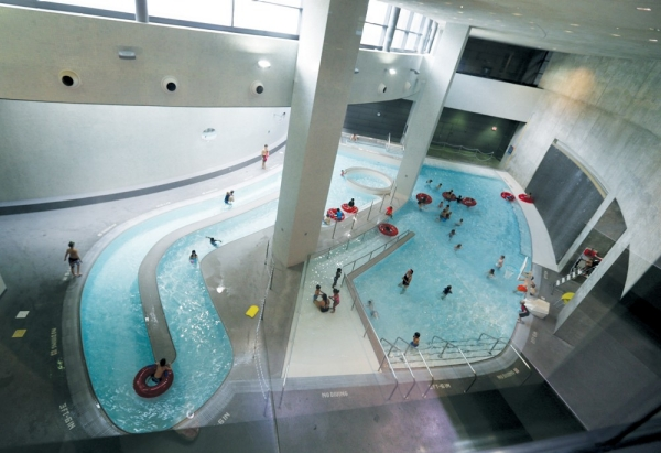 An overhead view looking down on a curving wade and current swimming pool at the University of Cincinnati.