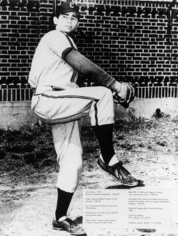 Black and white image captures Sandy Koufax at the University of Cincinnati as he pitches.