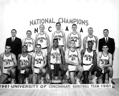 Team photo shows the 1961 UC bearcats basketball team with their coaches.