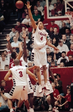 Kenyon Martin stretches out high into the air to block a player's shot.