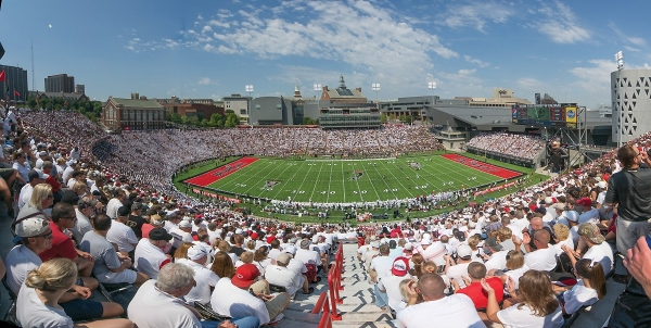 Thousands of UC fans mostly in white, are seated Nippert Stadium, UC's football facility.