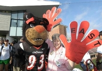 Bearcats fan Barb Cannon brought out her big hands for the Big East party July 1.  photo/Lisa Ventre