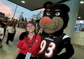 Marianne Kunnen-Jones gets chummy with the Bearcat during the morning gathering for UC employees. photo/Dottie Stover