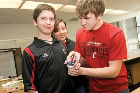 UC engineering students Jake Turner and JosiHerren with 14-year-old Ryan Korengel