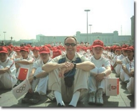 China launched its Olympic torch relay from Tiananmen Square, where Bill Kavanagh sits with 5,000 children.