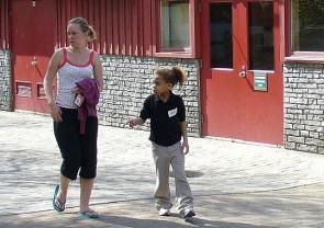 UC student volunteer and child.