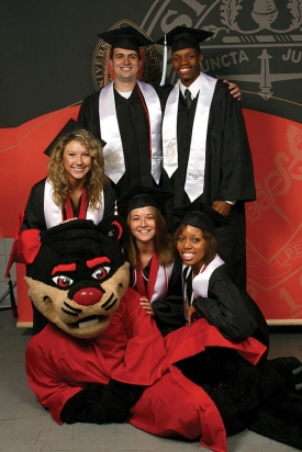 UC senior class officers pose with the Bearcat at graduation. Left to right are Stevi Gable, DAAP '08; Rob Haverkamp, Bus '08; Natalie Kohne, CCM '08; Reggie Bolding Jr., Ed '08; and Martina Jones, A&S '08.