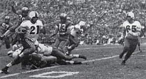 Bob Stratton, left, and teammate Lee Haslinger run toward the end zone in this game from the 1951 Bearcat football season.
