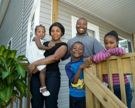 The Muianga family moved into a UC/Habitat home in 2007. Left to right are Marla (being held by) Edite, Custodio (a UC doctoral student), Edivale and Maile.