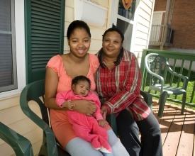Habitat Home Owner Janie Cunningham, daughter Samantha and granddaughter Sanyliah