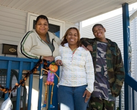 Silvia Smith and her children, Sharvee and Jeremy, celebrated their move into the first