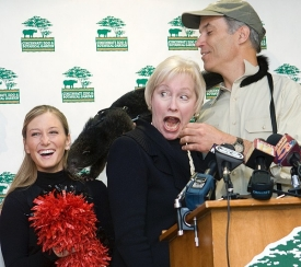 Three-month-old Lucy surprised UC President Nancy Zimpher in taking a shortcut from Thane Maynard to UC cheerleader Haley Cook at the press conference introducing the bearcat to the community. photo/Lisa Ventre