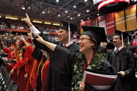 Singing the Alma Mater is one of many traditions during UC's commencement ceremony.