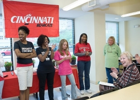 President Zimpher meets students from ACT, an organization that partners with UC's Raymond Walters College to allow working adults with dependent children to pursue a college education.  photo/Lisa Ventre