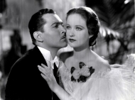 "Kent Taylor kissing Evelyn Venable in ""Death Takes a Holiday."""