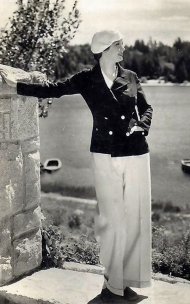 Evelyn Venable, posed lakeside in a casual outfit