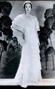"Evelyn Venable in a long white designer dress for ""Death Takes a Holiday."""