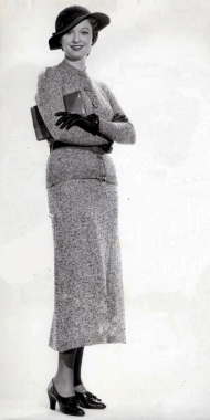 Venable wearing a smart skirted suit and hat