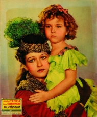 "Evelyn Venable with Shirley Temple in an ad for ""The Little Colonel."""