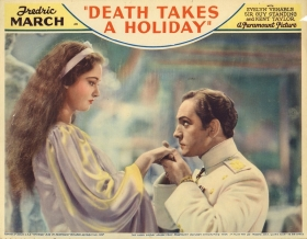 "A lobby card for ""Death Takes a Holiday,"" starring Venable and Fredric March."