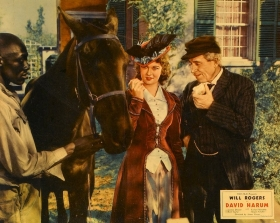 "A lobby card for ""David Harum"" with Venable and Will Rogers."