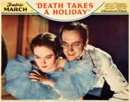 Lobby card of Evelyn Venable and Fredric March in Death Takes a Holiday.
