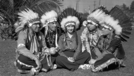 Evelyn Venable sitting with four Native American chiefs.