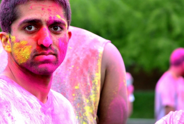A UC student takes part in the Holi Festival on Sigma Sigma Commons.