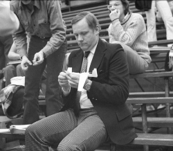 Neil Armstrong makes a paper airplane in 1974.