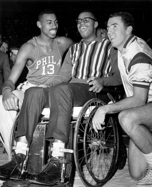 Wilt Chamberlain with Maurice Stokes in a wheelchair and Jack Twyman.