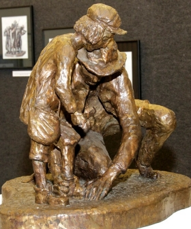 At Rolat's exhibit was a touching bronze sculpture of a father untying his son's shoes.