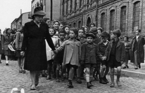 Children who survived the Holocaust in Czestochowa walking down the street.