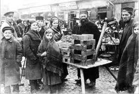 A Jewish street vendor selling bars of soap in a Czestochowa marketplace.