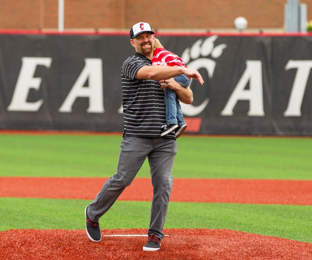Former University of Cincinnati baseball player and major leaguer Kevin Youkilis throws a ceremonial first pitch.