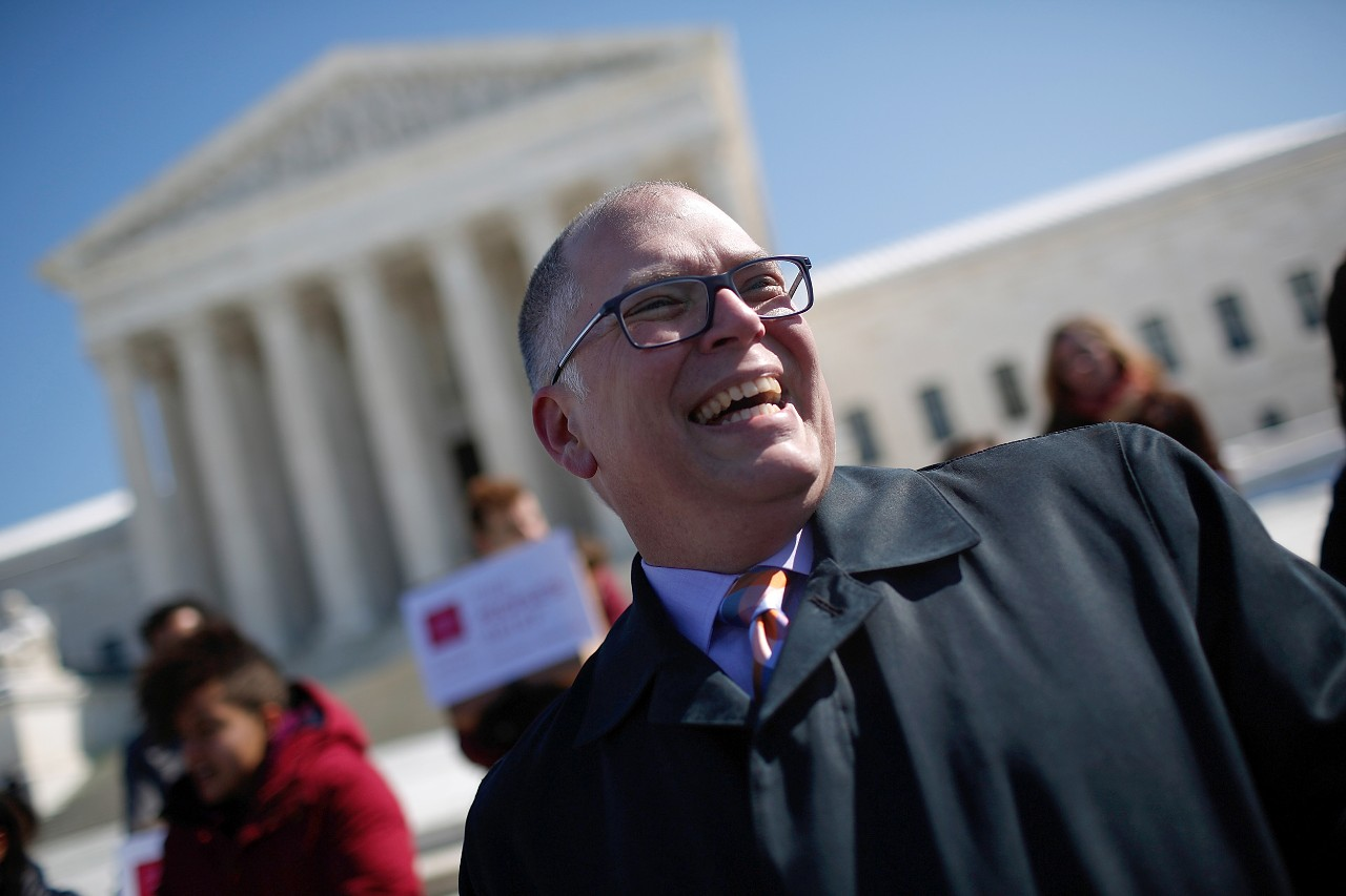 A smiling Jim Obergefell stands on the steps of the U.S. Supreme Court. Obergefell's case on same-sex marriage was brought to the court.