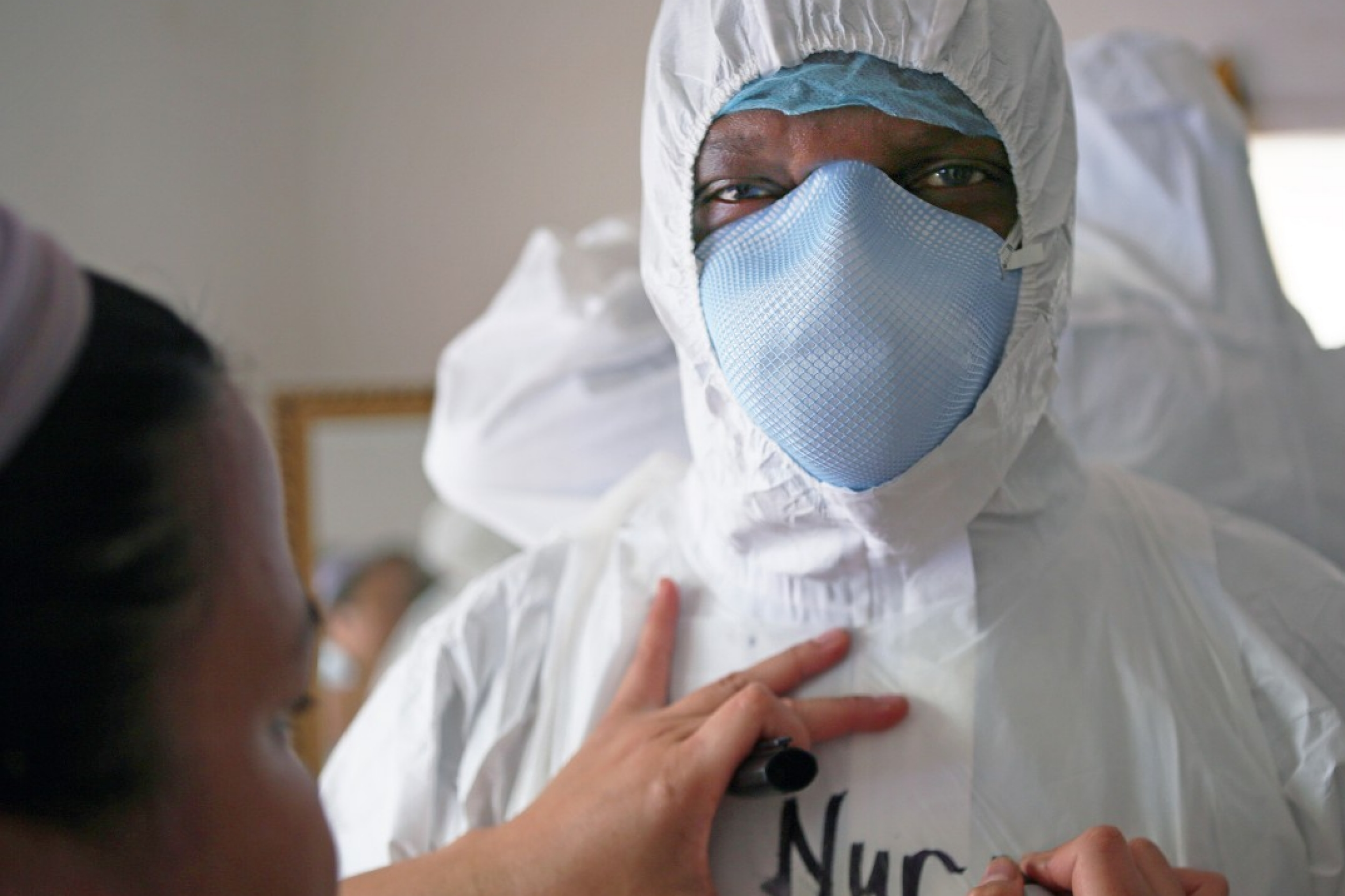 UC College of Nursing Professor Cheedy Jaja prepares to treat Ebola patients in Sierra Leone.