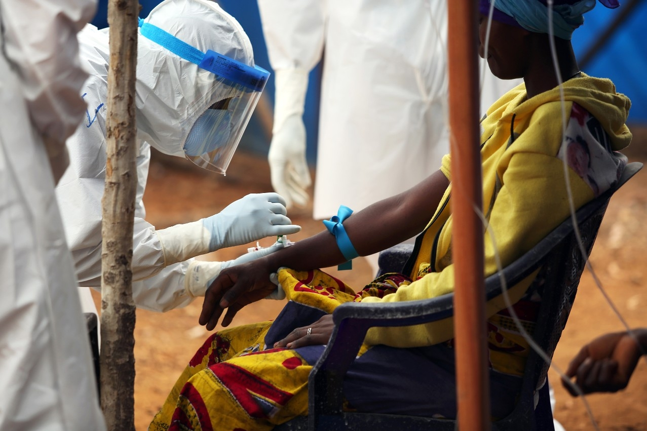 A volunteer from Partners in Health treats a patient in the Maforki Ebola Treatment Unit in Sierra Leone.