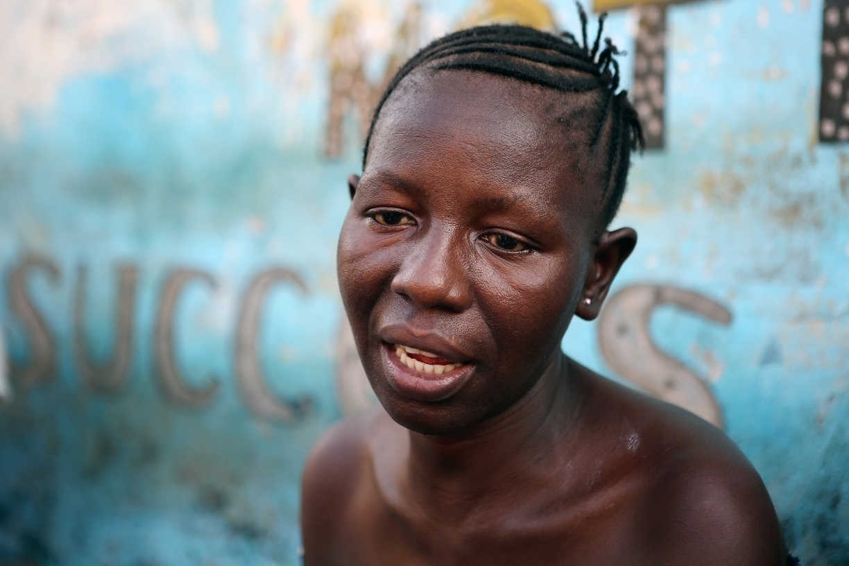 An Ebola survivor in Sierra Leone sits and shares her story.