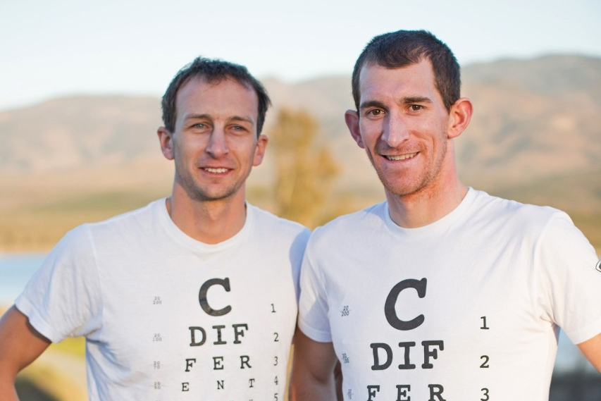 Aaron Sheidies and Colin Riley stand next to road in California wearing cdifferentwithaaron.com t-shirts.