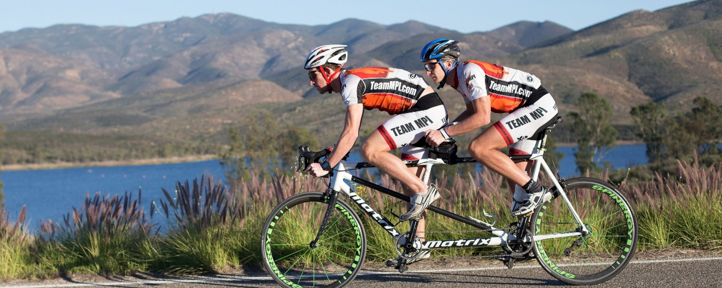 Colin Riley and Aaron Sheidies ride a tandem bike through the mountains of Chula Vista, Calif. photo/Marcy Browe
