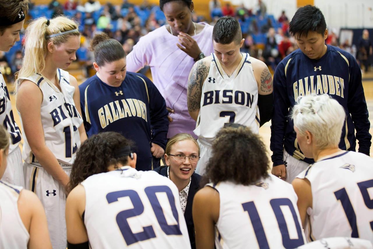 Gallaudet coach Stephanie Stevens communicates with her team during a timeout.