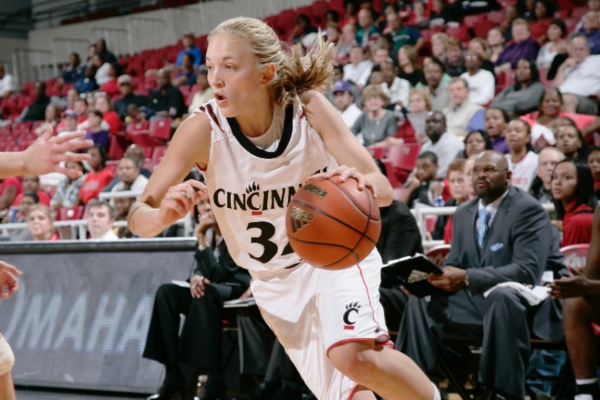 Stephanie Stevens dribbles toward the basket as a Bearcat player.