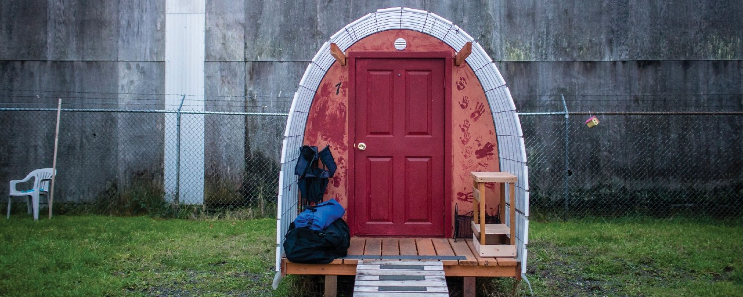 The front door of a tiny house in Opportunity Village in Eugene, Oregon.